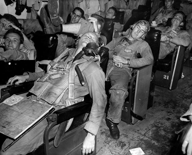 lieutenant-jg-john-h-cantrell-left-and-lieutenant-john-l-carter-catch-40-winks-in-the-ready-room-nov-1944